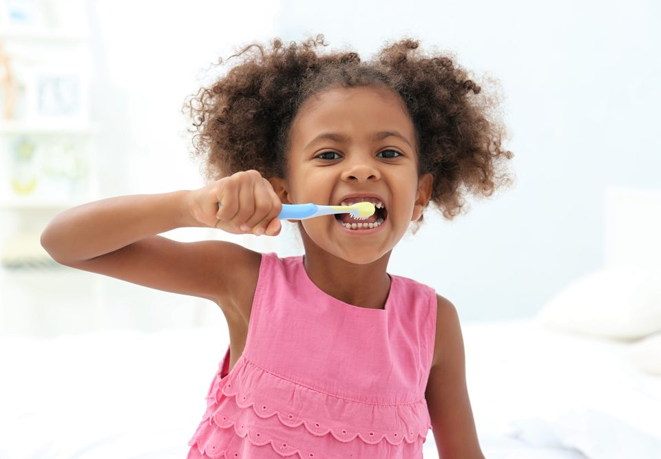 risks children brushing too hard